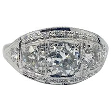 Period Three Stone Solid Ring with total diamond weight of 1.69 carats (three main diamonds total 1.45ctw)
