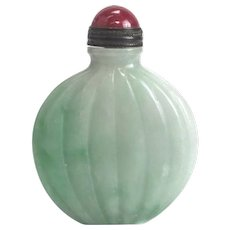 Chinese Jadeite Jade Snuff Bottle, with red gemstone lid. Bright green to light