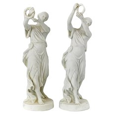 Pair of Sevres Style Bisque Porcelain Figurines of Women Deity Figures holding wreaths