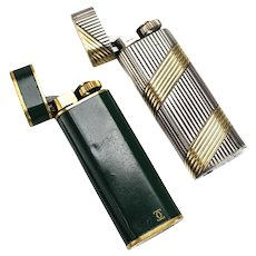 Pair of Cartier Lighters, the estate of Walter & Carol Matthau Sterling 18k Enamel