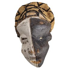 African Pende Wood Carved Mask, pigment painted white and black, woven cloth