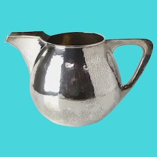 TC Shop Chicago, Arts and Crafts Hand hammered Sterling Silver Pitcher c1920