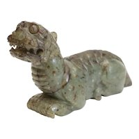 Jade Guardian Lion, hand carved in green spotted jade