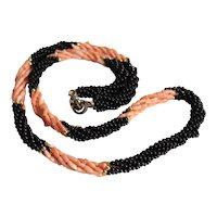 Coral and Onyx braided necklace with gold beads, Steel Closure