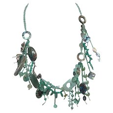Hand tied macramed ocean themed necklace with various sea green gemstones