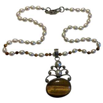 Shimmering Tiger Eye cabochon with hand knotted Pearl necklace
