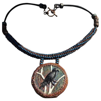 Raven pendant on beaded leather with copper and blue accents
