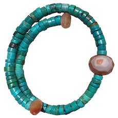 Turquoise heishi beads on memory wire with Carnelian  ends large Carnelian feature bead