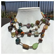 "Multiple gemstones,Czech beads,and agates macramed into 72"" rope"