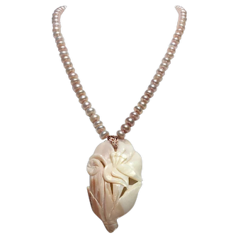 Carved Mother of Pearl lily and leaf pendant on hand knotted pearl necklace