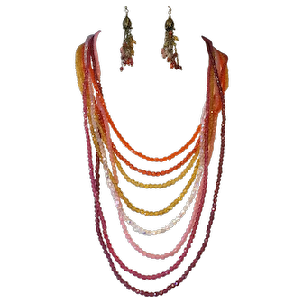 Multiple strand necklace of warm to hot shades of fire polished Czech beads