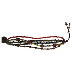 Colorful BoHo style bracelet with multi colored beads and easy slide closure