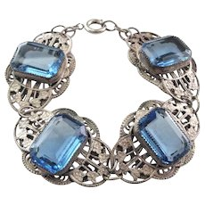 Art Deco Simulated Sapphire Blue Glass Silver Tone Brass Filigree Bracelet with Floral Design
