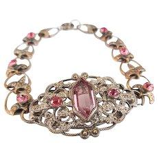 Art Deco Pink Glass Rhinestone Gold Tone Brass Filigree Bracelet with Fleur De Lis Design