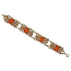 Czech, Neiger, orange/rust molded glass, and brass bracelet