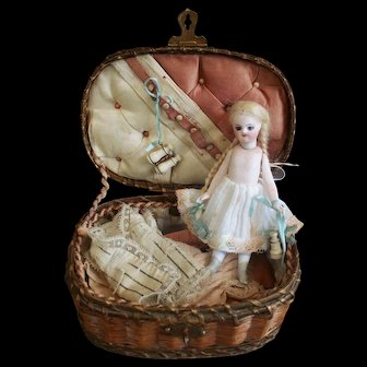 Early french all bisque mignonette doll in presentation basket