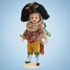 Rare S&H all bisque mignonette doll with Harlequin costume and presentation egg - Original condition