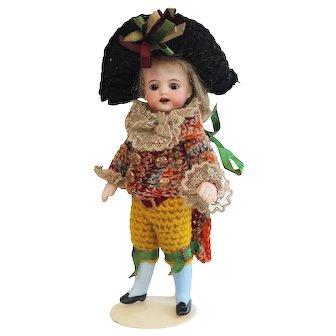 Rare S&H all bisque mignonette doll with Harlequin costume - Original condition