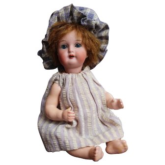 Adorable tiny character doll with baby body K&R 126-16