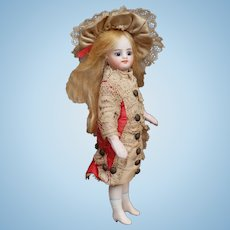 Exceptional French mignonette all bisque doll - Factory dress and very rare white-cream boots