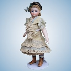 """Early 6.5"""" French all bisque mignonette doll with unique boots - Circa 1880"""