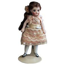 """4.3""""  French type all bisque mignonette doll"""