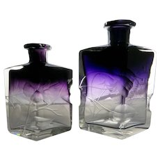 Two Moser Crystal Amethyst Floral Intaglio Cut Perfume Bottles.
