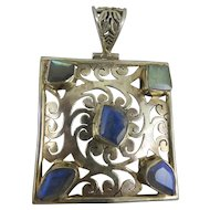 Sterling Silver and Opal Arts and Crafts Style Pendant