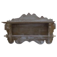 Antique 19th century rustic wood kitchen hand towel shelf in white and beige with brass hooks .