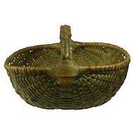 Large antique gathering basket in Folk Art green .