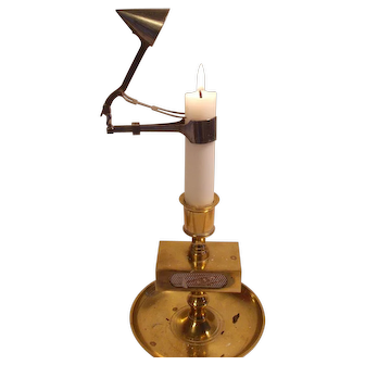 Old Victorian style automatic candle snuffer Swedish made in plated metal .