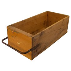 Antique primitive 19 century wagon seat pine wood box with wrought iron handle in dove tail construction .
