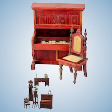 Beautiful & antique doll house Piano and Chair of red colored wood by the German company Gebruder Schneegas.