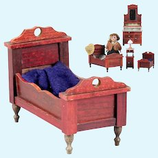 Beautiful & antique doll house Child Bed of red colored wood by the German company Gebruder Schneegas.