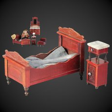 Beautiful & antique doll house Bed and Bedside Table of red colored wood marble top by the German company Gebruder Schneegas.