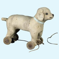 Antique French pull toy dog with button eyes steiff related