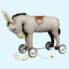 Antique French pull toy on wheels Donkey with glass eyes Steiff related