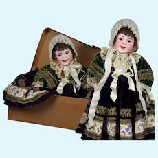 "Totally original French provincial clothing and box SFBJ 236 ""Smiling Jumeau character Bebe"