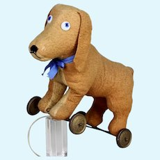 Antique French pull toy dog with glass eyes steiff related