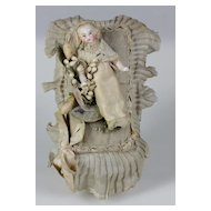 Antique French candy container with a little baby doll all - bisque wax flowers circa 1880