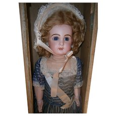 "22"" Antique bisque doll French tete Jumeau  size 10,  closed mouth,  blue eyed.  marked jumeau  shoes.  boxed seT"