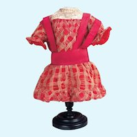 Magenta-red silk dress with ribbon overlay