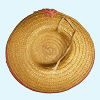 French chapeau in a deep honey straw featuring a cherry red band