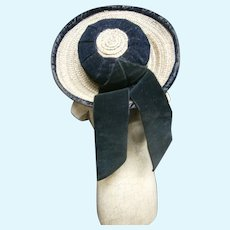 Lovely french straw hat featuring black silk velvet trim