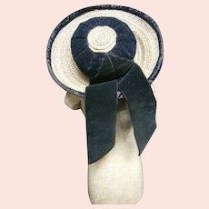 Lovely french straw hat featuring black silk velvet trim