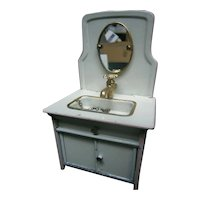 Loveliest tin doll`s toilette table with sink and oval mirror  , tap and down cupboard with 2 doors
