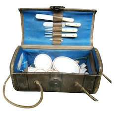 Exceptional leather  handbag/box  with  doll`s miniture size crockery  and cutlery