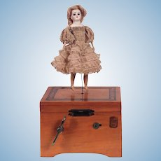 antique French mechanical musical Dancing Doll with Original Au Louvre Label music box.