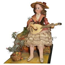 "French automaton "" lady playing the mandoline "" in the country scenery"