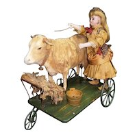 Rarest  antique  automaton FRENCH pulltoy, a girl with a cow in platform with wheels.